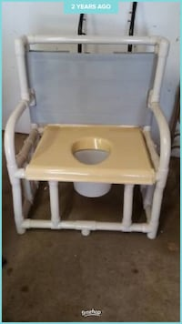 Beige and white commode holds 600lbs Hazel Park