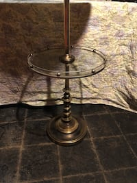 Brass base glass top table lamp.