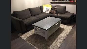 Grey sectional couch, right facing