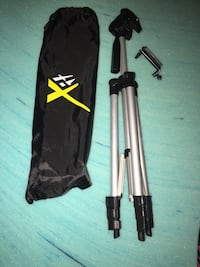 gray and black tripod with bag