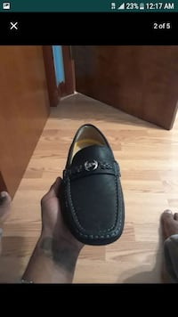 Pair black leather slip on shoes
