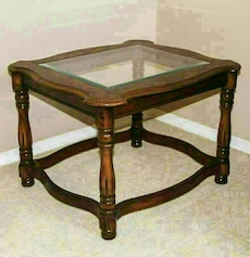 brown wooden framed glass top end table