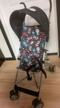 Folding Stroller with Sunshade - used one day.