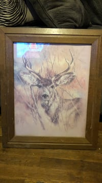 Brown buck painting with brown wooden frame