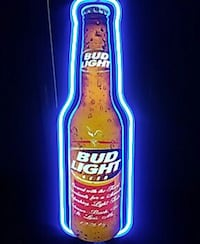 blue and brown Bud Light beer bottle neon signage