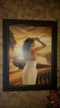 black wooden framed woman back view painting