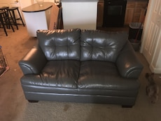 Gray leather love seat