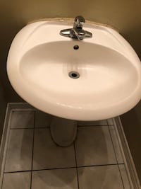 white ceramic sink with faucet Markham, L6E 0B4
