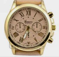 round gold chronograph watch with brown leather strap Hamtramck, 48212