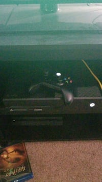 black Xbox One console with controller 26 mi