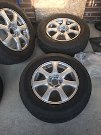 Chrome 5-spoke car wheel with tire set  . I6 inches aftermarket rims . Came off 2010 rav 4. Type size is 215 /70/16. Tyres are in good condition.  Toronto, M3M 2M4