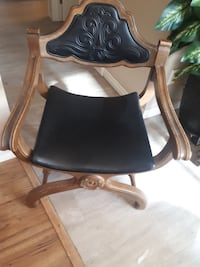 black and brown leather padded armchair 3166 km