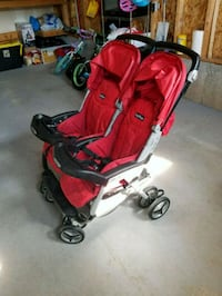 baby's red and black stroller 624 km