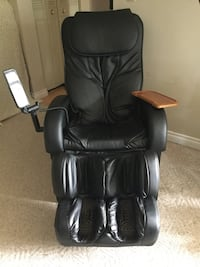 Black leather padded rolling armchair ,massage chair Camrose, T4V 1N1