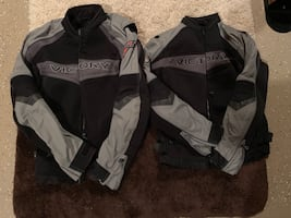 Men's and Women's Victory Motorcycle Jackets with protective padding.