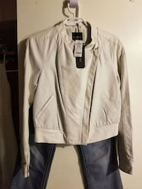 White bebe leather. Melville, S0A 2P0