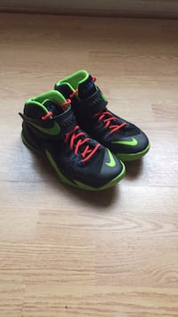 Pair of black-and-green nike running shoes Frederick, 21702