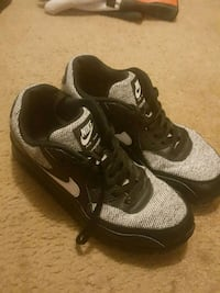 pair of black-and-gray Nike running shoes Davenport, 52808