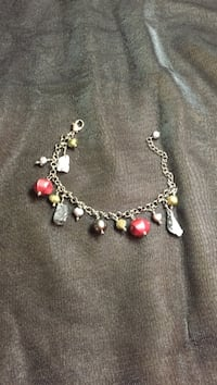 Beaded red and brown with silver-colored chain bracelet