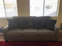 Gray couch and loveseat, pillows included; sleeper in couch Las Vegas, 89122
