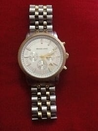 round silver Michael Kors chronograph watch with link bracelet New York