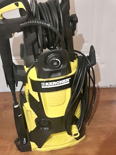 black and yellow Karcher vacuum cleaner