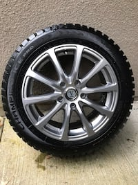 gray multi-spoke vehicle wheel and tire Burnaby, V5A