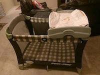 baby's brown and white Graco pack n play San Diego, 92154