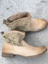 Pair of brown ROXY lace boots