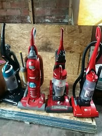 three red and blue upright vacuum cleaners Elizabeth, 07206