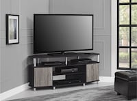 black flat screen TV and black wooden TV stand Detroit, 48202