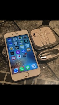 silver iPhone 6 with charger and EarPods 882 mi