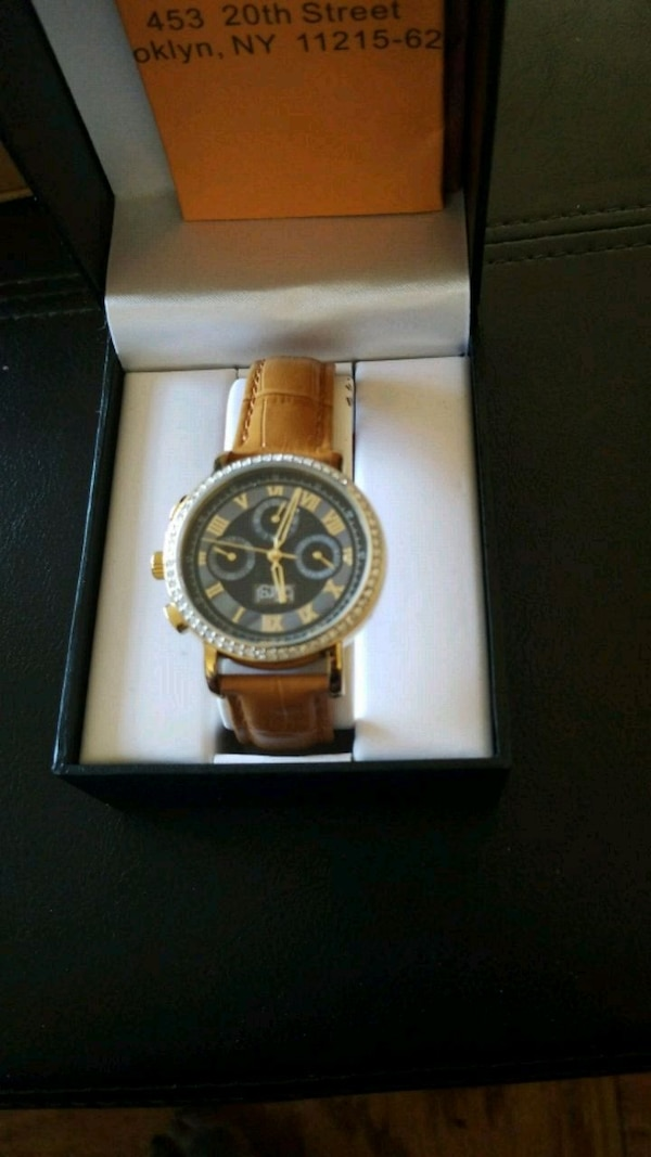 round silver chronograph watch with brown leather strap in box 98980bfd-c781-4d9c-b72f-77706241a9c2