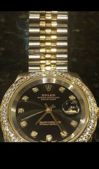 round gold Rolex analog watch with link bracelet null