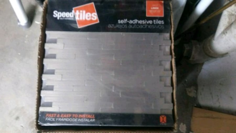2 Brand New Boxes of peel & stick tiles 24 in a box 7d66611a-7ba8-41e3-b47f-fb5c43853012