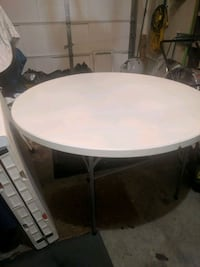 """NEW. 48"""" round foldable plastic table $50.00"""