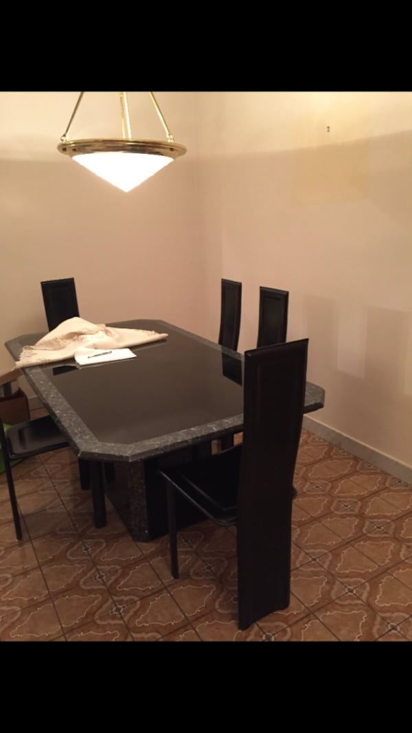 Table with six leather chairs a4846547-17bb-48e1-9730-2bb03445364d