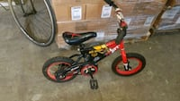 toddler's red and black bicycle with training wheels Mississauga, L4X 1R1