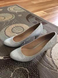Ladies silver dress high heel shoes.  Never worn    Size 7.5.