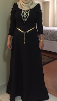 women's black long sleeve maxi dress with gold-colored belt