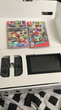 Black nintendo switch with 2 games Beacon