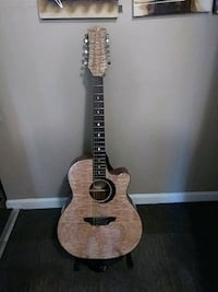 brown and black acoustic guitar Vallejo, 94590