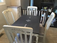 Rectangular distressed wooden table with 4chairs dining set freshly reupholstered St Catharines, L2P 3L2