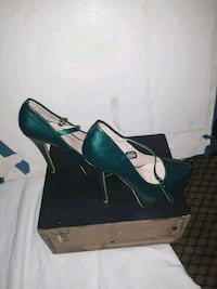pair of green suede platform stiletto shoes with b 2332 mi