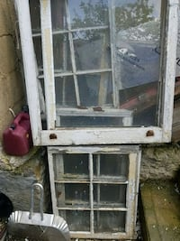 white wooden framed glass window from 1930s