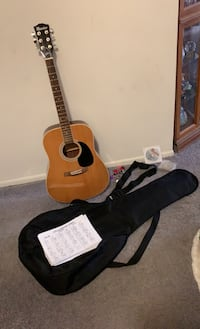 Guitar with a case, strap,beginner notes, CD, strings,and guitar picks