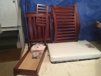two brown wooden rocking chairs Boca Raton, 33433