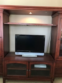 black flat screen TV with brown wooden TV stand Palmdale, 93551