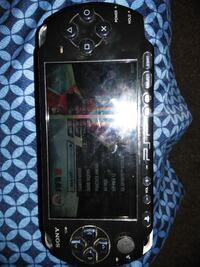 black Sony PSP handheld game console Lithonia