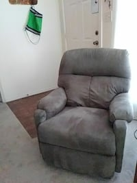 Two matching recliners. 1 good condition, 1 poor. $50 for good one.